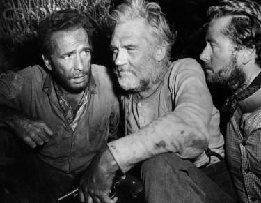 Humphrey Bogart, Walter Huston, and Tim Holt